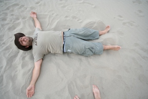 "Nick tries to teach me how to make a ""Sand Angel"""